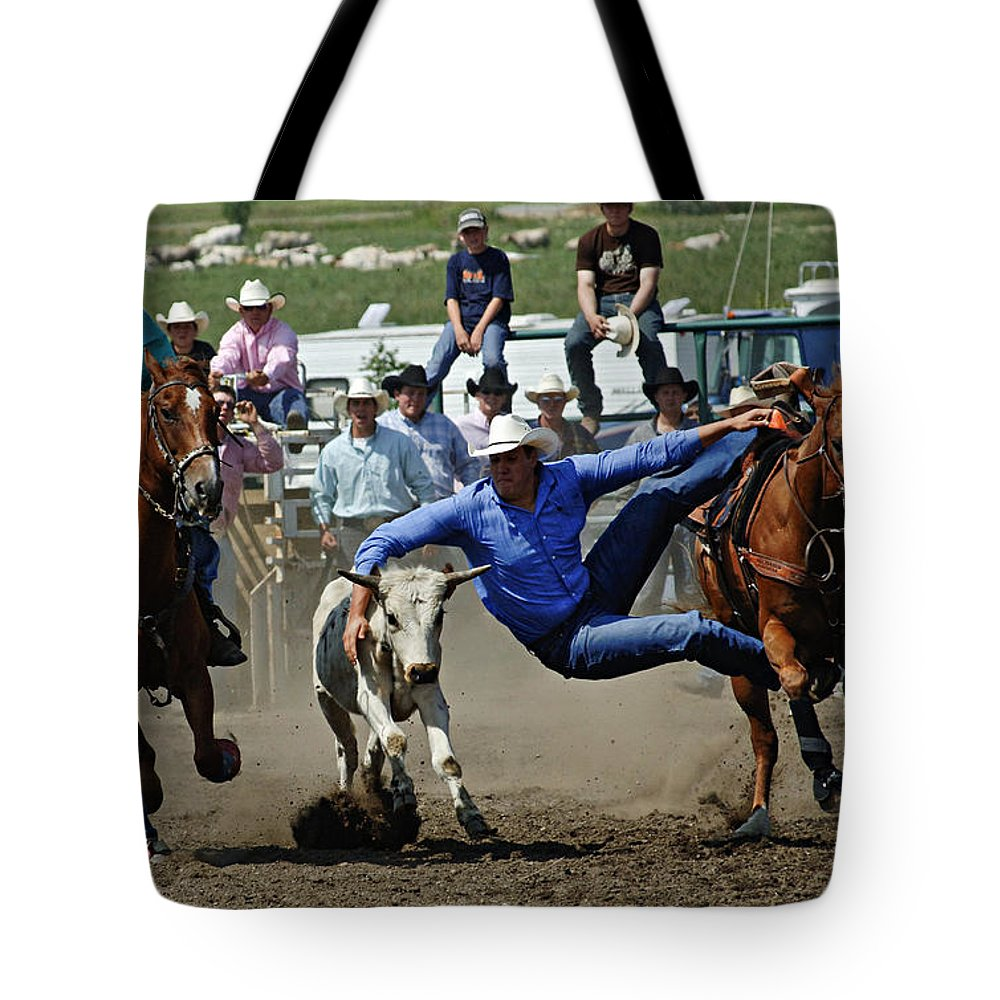 Rodeo Tote Bag featuring the photograph Rodeo Steer Wrestling by Bob Christopher