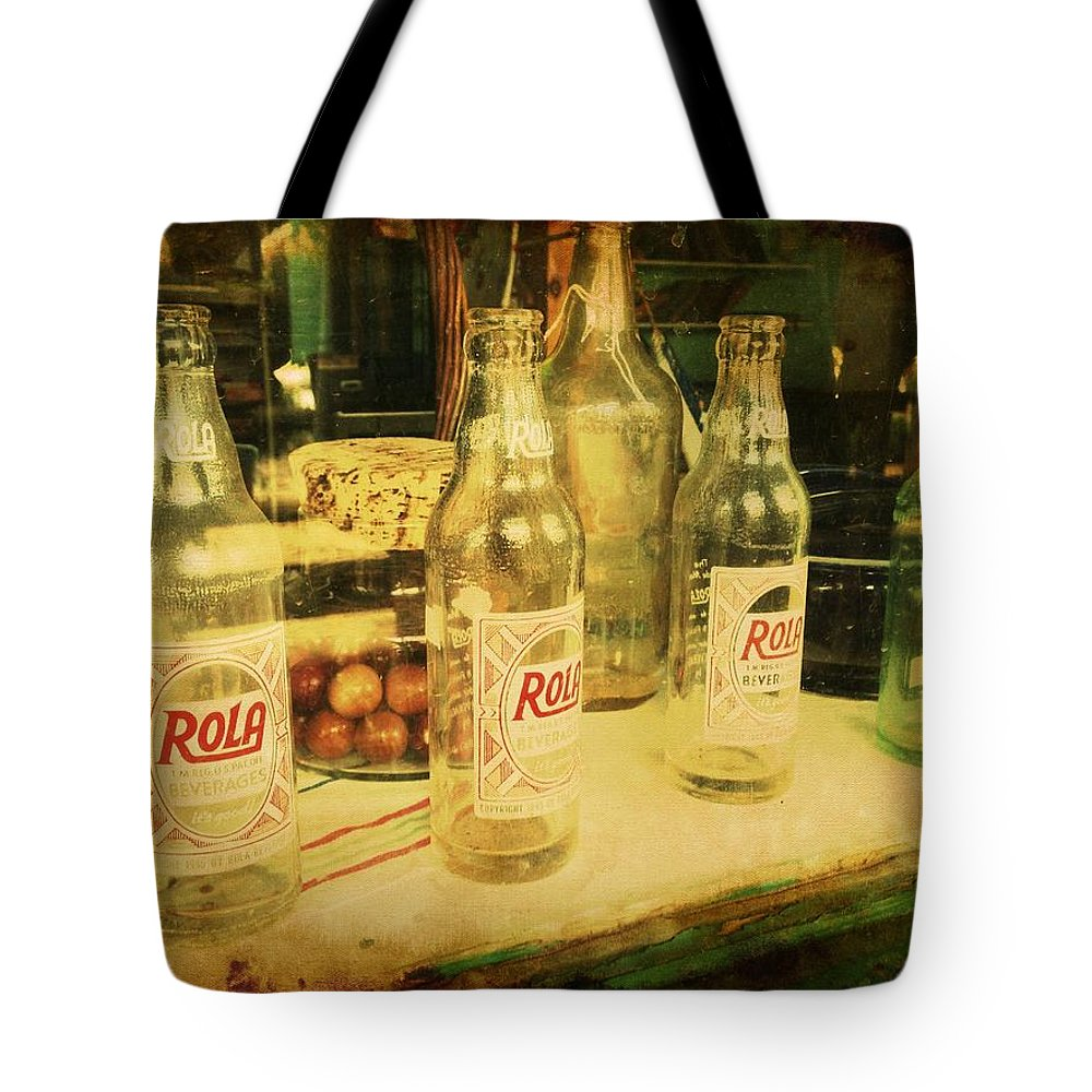 Rola Tote Bag featuring the photograph Rola Cola by Richard Reeve
