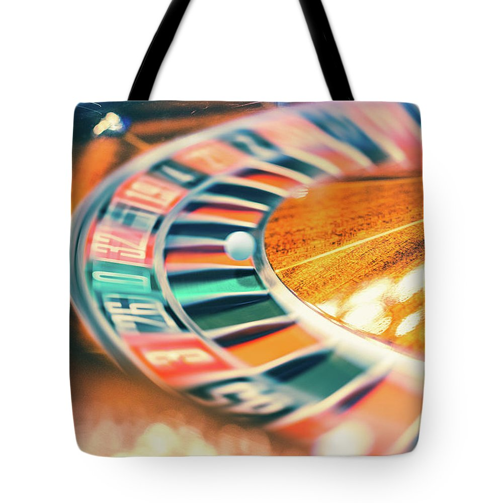 Risk Tote Bag featuring the photograph Roulette Wheel In Motion by Deimagine