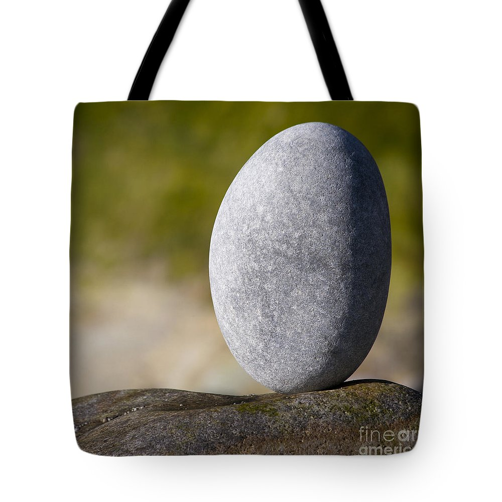 Heiko Tote Bag featuring the photograph Rounded By Flowing Water by Heiko Koehrer-Wagner