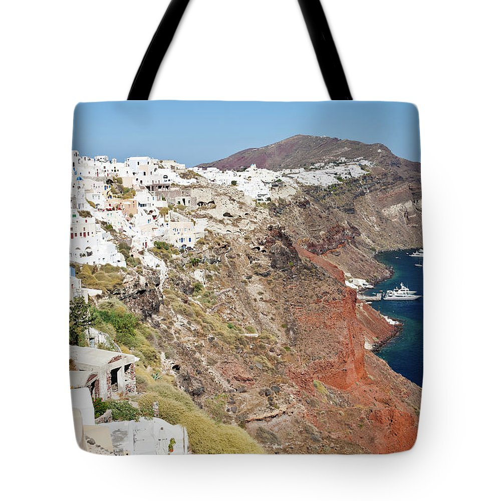 Tranquility Tote Bag featuring the photograph Rows Of Houses Perch On Cliff In Oia by Melissa Tse