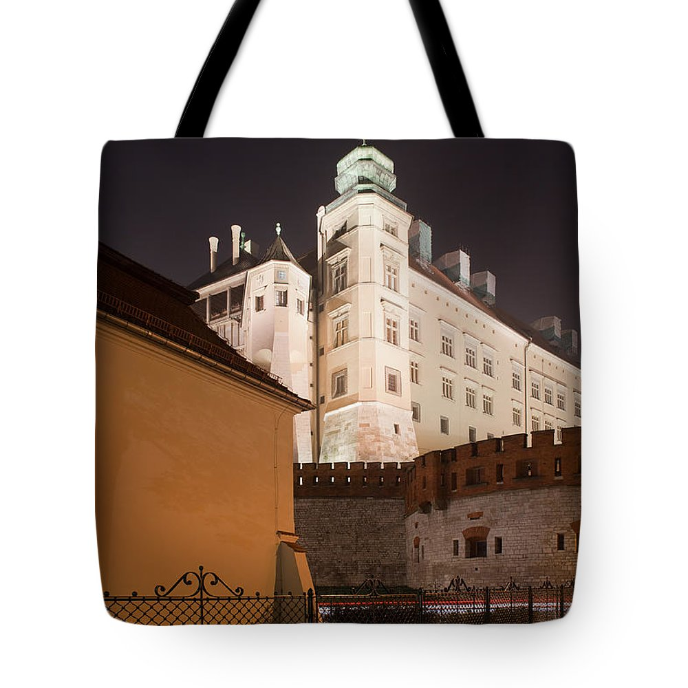 Wawel Tote Bag featuring the photograph Royal Wawel Castle By Night In Krakow by Artur Bogacki