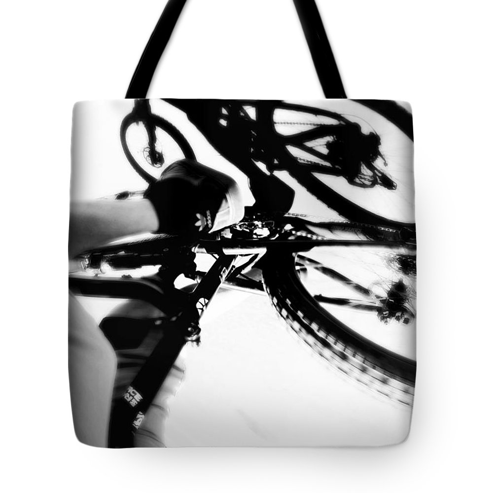 Bicycle Tote Bag featuring the photograph Rubber Side Down by Chris Phillips