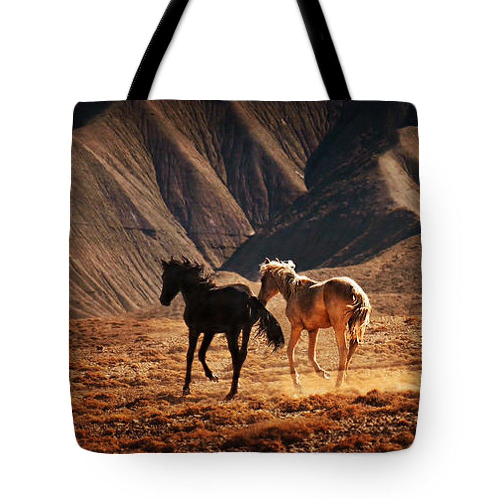 Wild Horses Tote Bag featuring the photograph Running Free by Priscilla Burgers