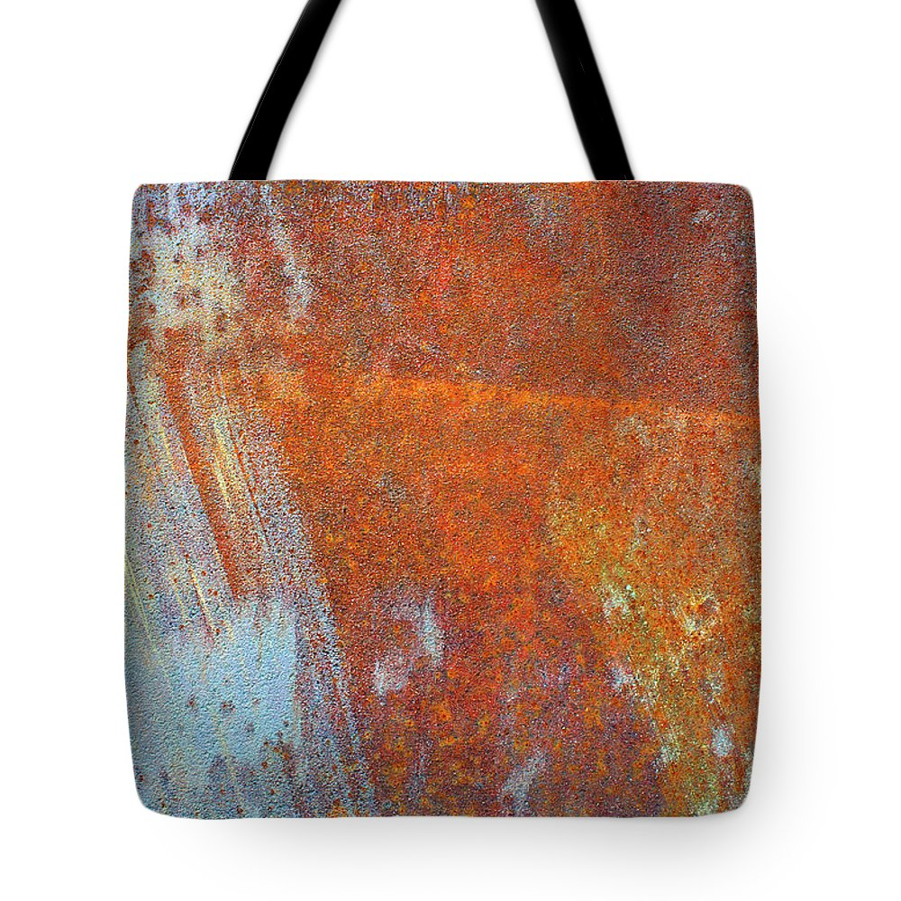 Aging Process Tote Bag featuring the photograph Rust On A Metal Surface by Rob Atkins
