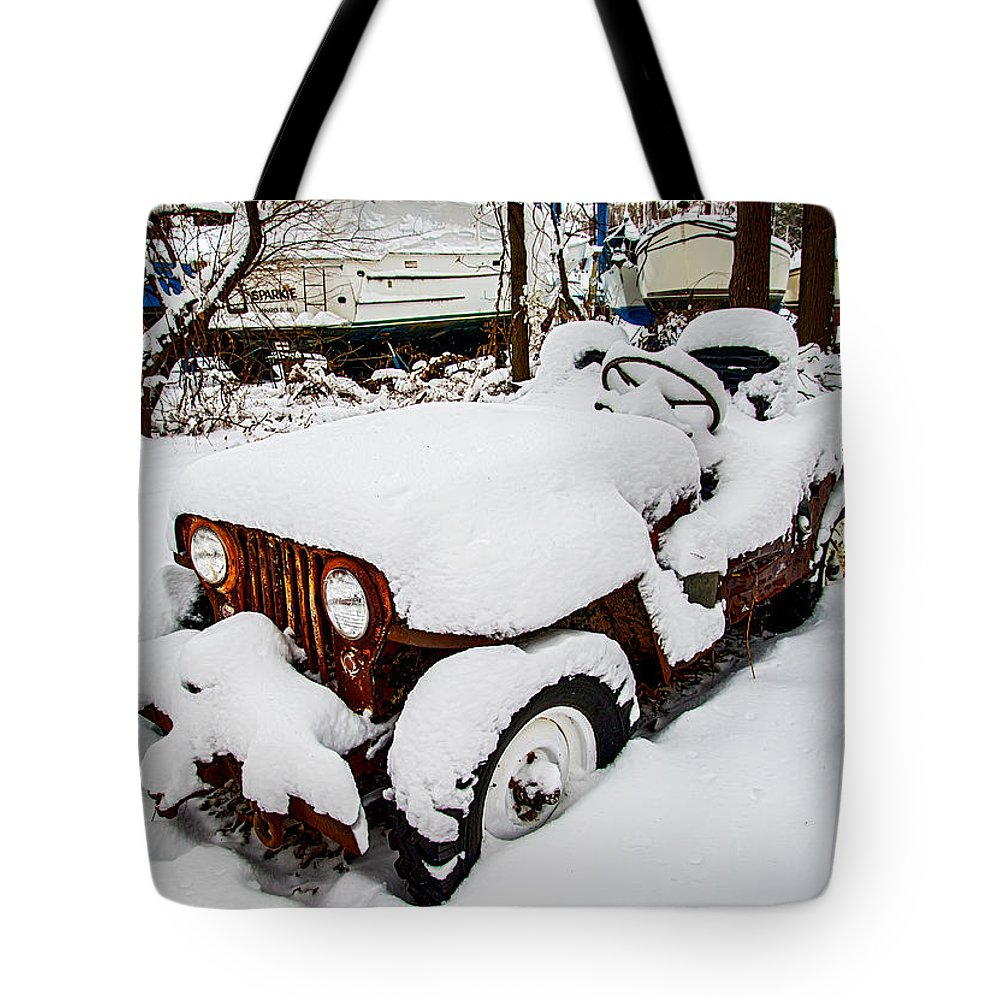 2d Tote Bag featuring the photograph Rusty Jeep In Snow by Brian Wallace