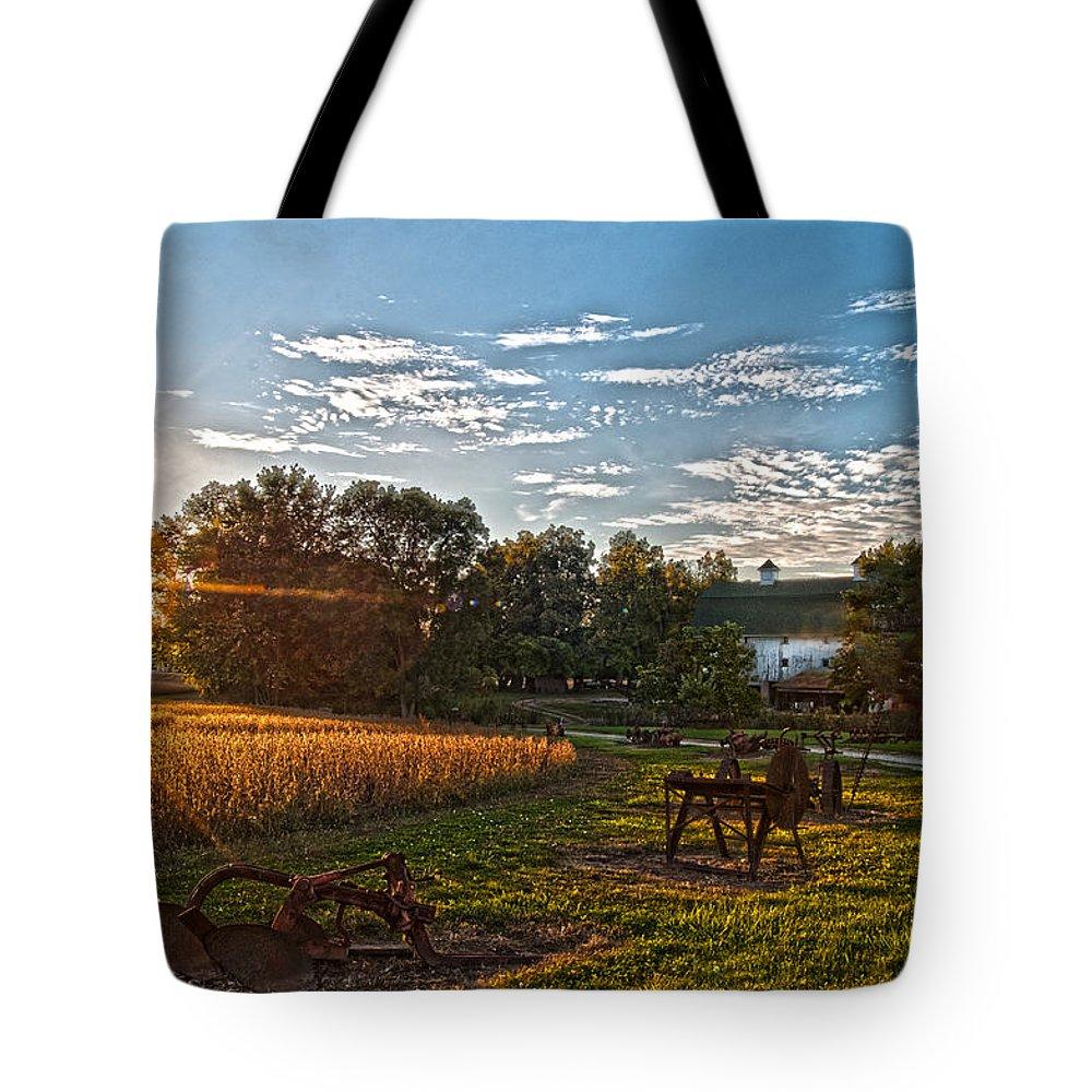 Farm Equipment Tote Bag featuring the photograph Rusty Old Farm Equipment by Randall Branham