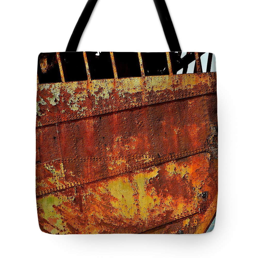 Rusty Tote Bag featuring the photograph Rusty Remains Of An Old Boat by Kirsten Giving