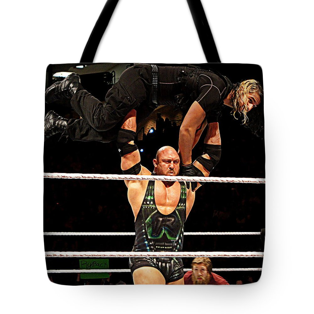 Ryback Tote Bag featuring the photograph Ryback And Shield by Paul Wilford