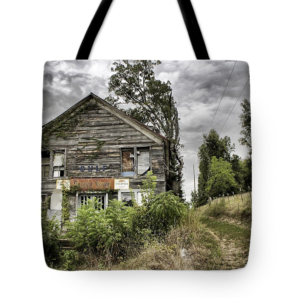 Rustic Tote Bag featuring the photograph Saddle Store 3 Of 3 by Jason Politte