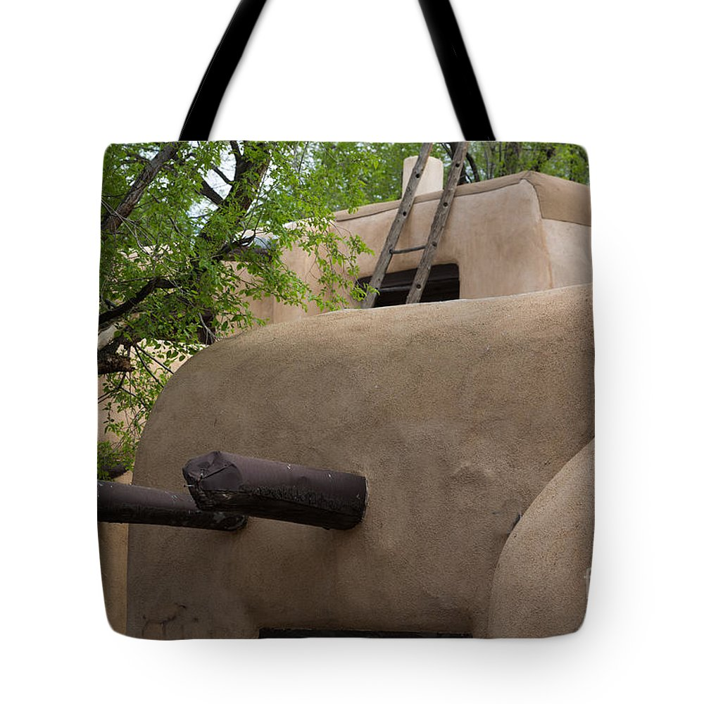 Adobe Architecture Tote Bag featuring the photograph Sagebrush Inn Taos Nm by Dan Hartford