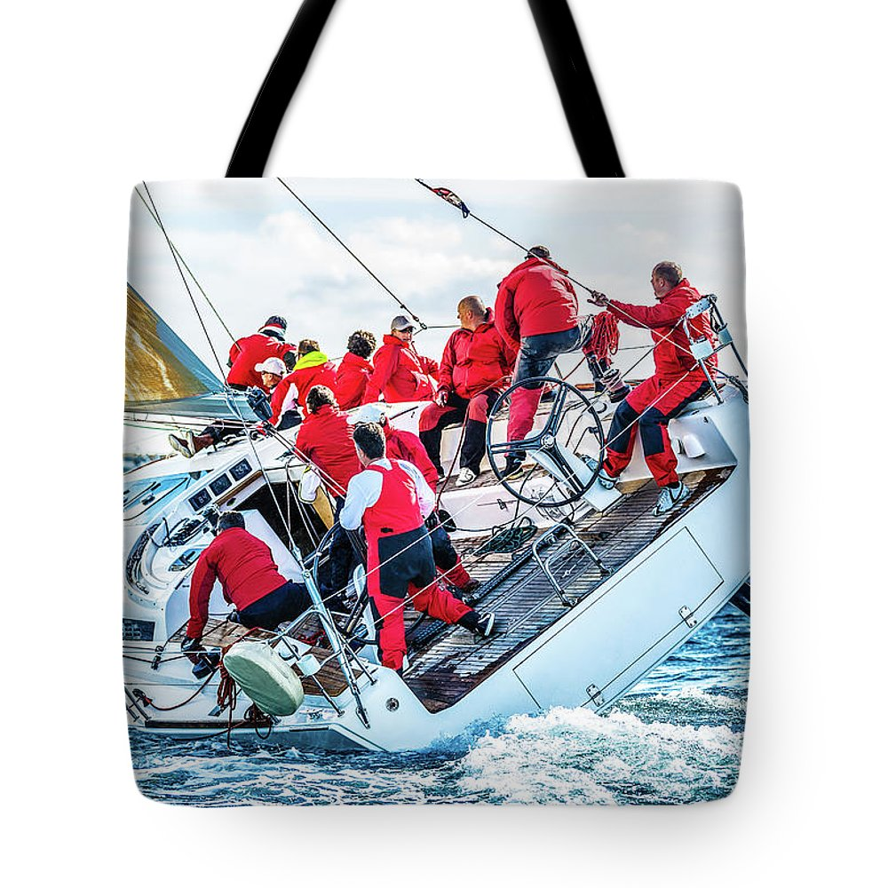 Adriatic Sea Tote Bag featuring the photograph Sailing Crew On Sailboat During Regatta by Mbbirdy