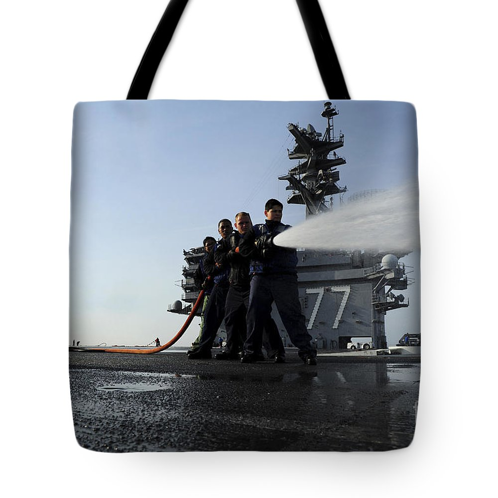 Military Tote Bag featuring the photograph Sailors Conduct Hose Team Training by Stocktrek Images