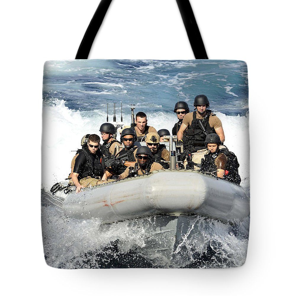 Rigid Hull Inflatable Boats Tote Bag featuring the photograph Sailors Conduct Maneuvers by Stocktrek Images