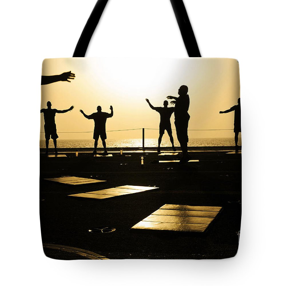Military Tote Bag featuring the photograph Sailors Exercise In The Hangar Bay by Stocktrek Images