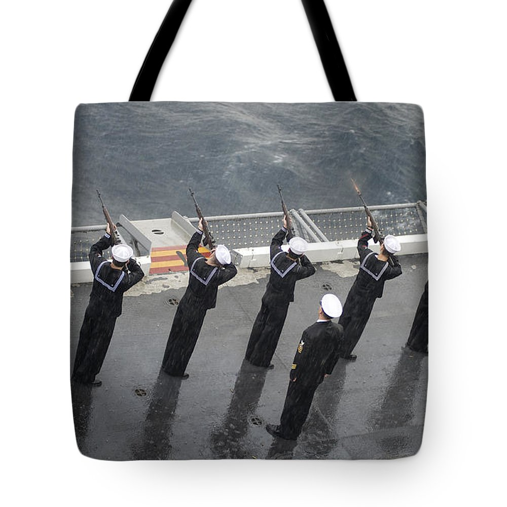 Military Tote Bag featuring the photograph Sailors Fire A 21-gun Salute by Stocktrek Images