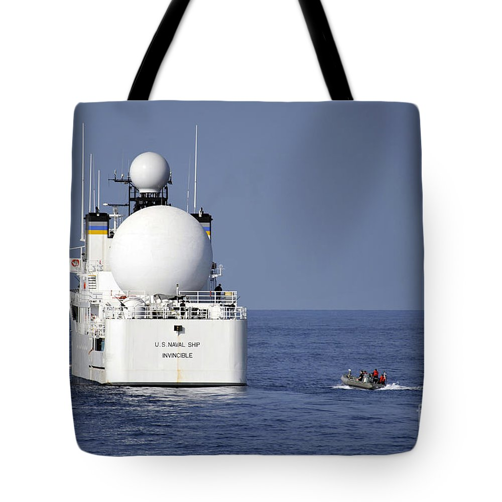Military Tote Bag featuring the photograph Sailors In A Rigid-hull Inflatable by Stocktrek Images
