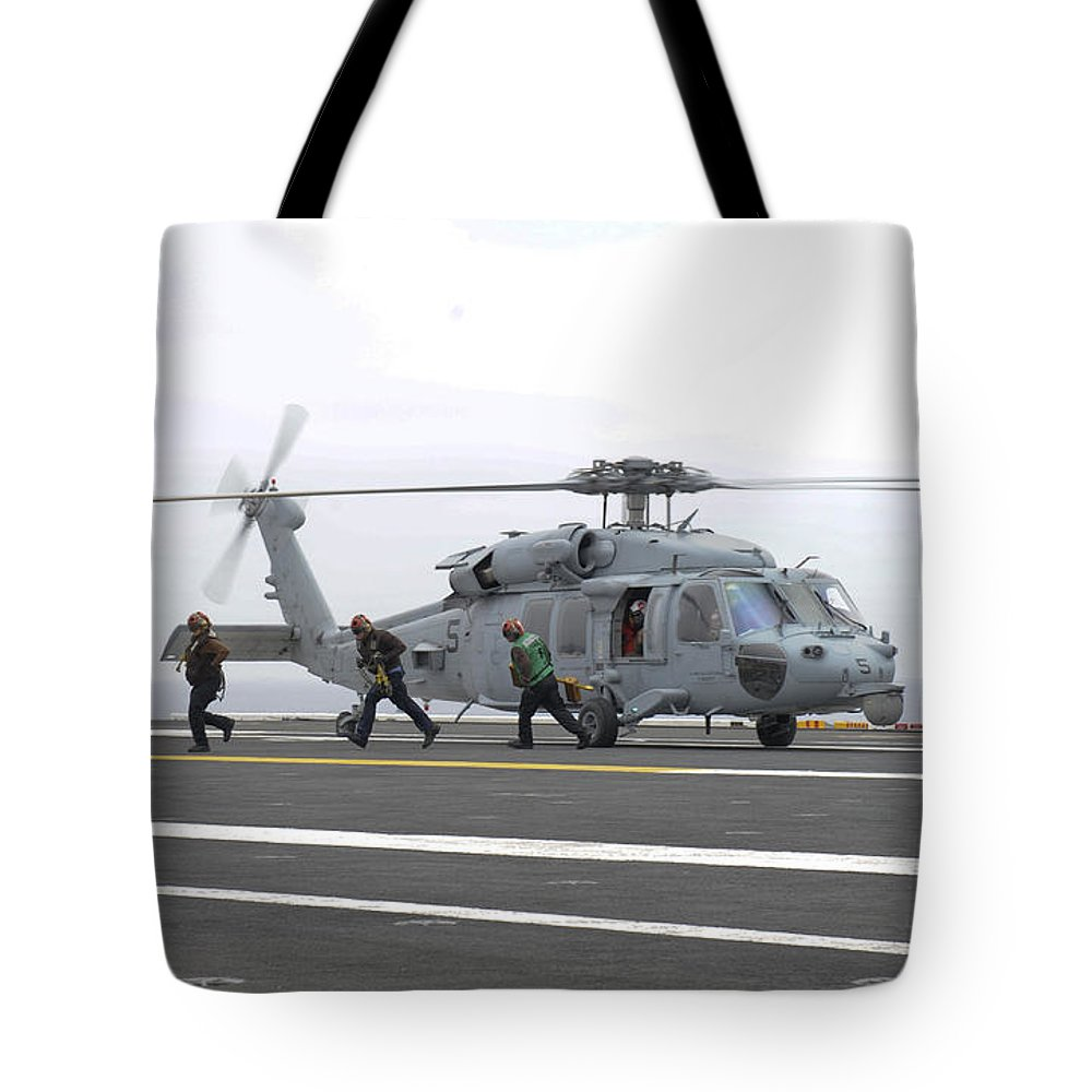 Military Tote Bag featuring the photograph Sailors Leave The Landing Area Of An by Stocktrek Images