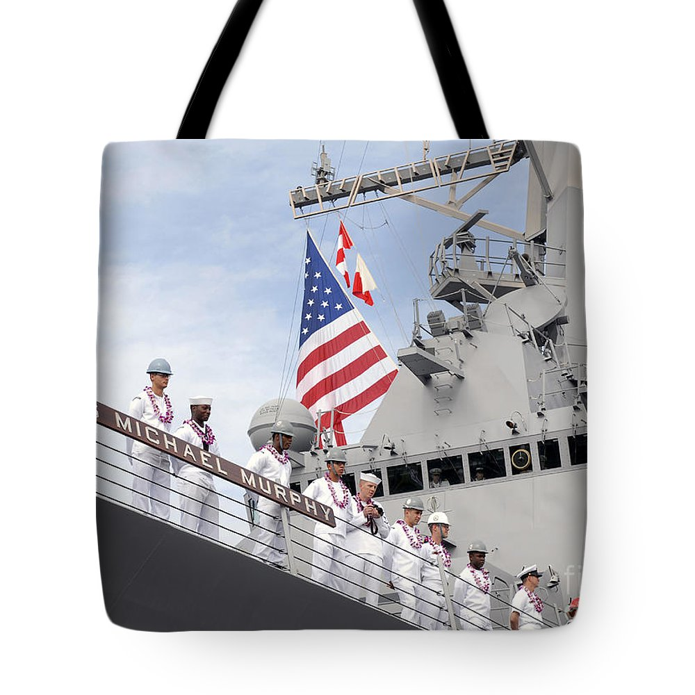 Uss Michael Murphy Tote Bag featuring the photograph Sailors Man The Rails Aboard Uss by Stocktrek Images