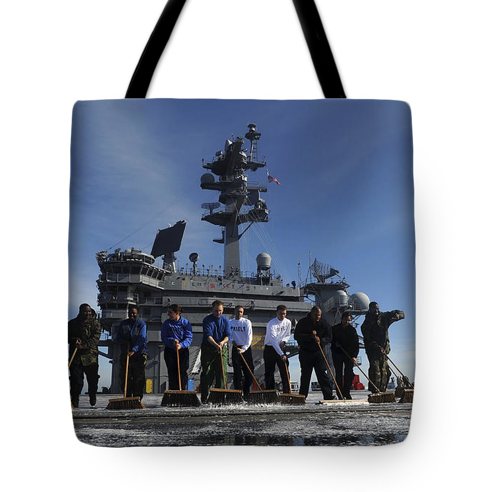 Military Tote Bag featuring the photograph Sailors Participate In A Fight Deck by Stocktrek Images