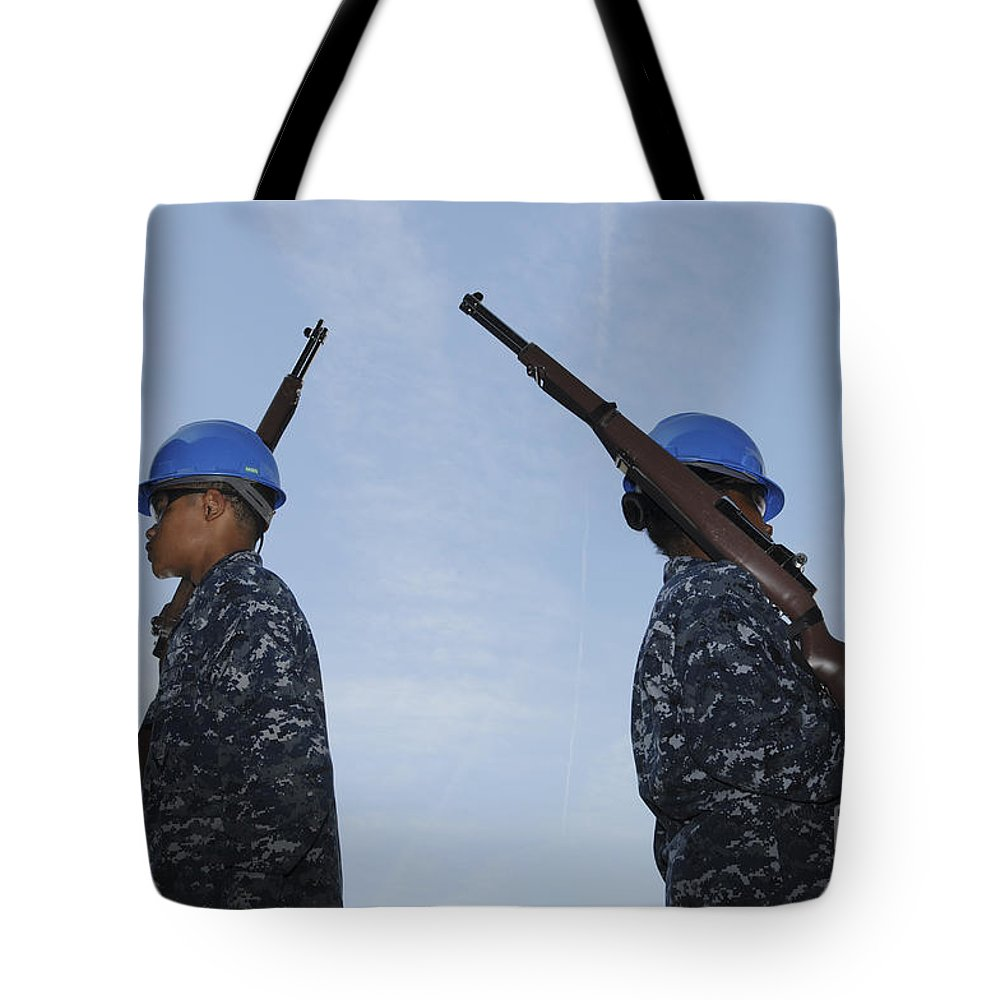 Military Tote Bag featuring the photograph Sailors Practice A Routine Aboard Uss by Stocktrek Images