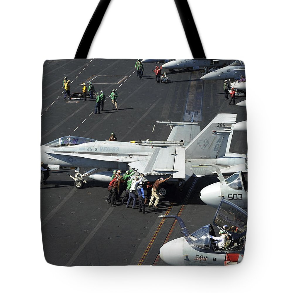 Military Tote Bag featuring the photograph Sailors Push An Fa-18c Hornet by Stocktrek Images