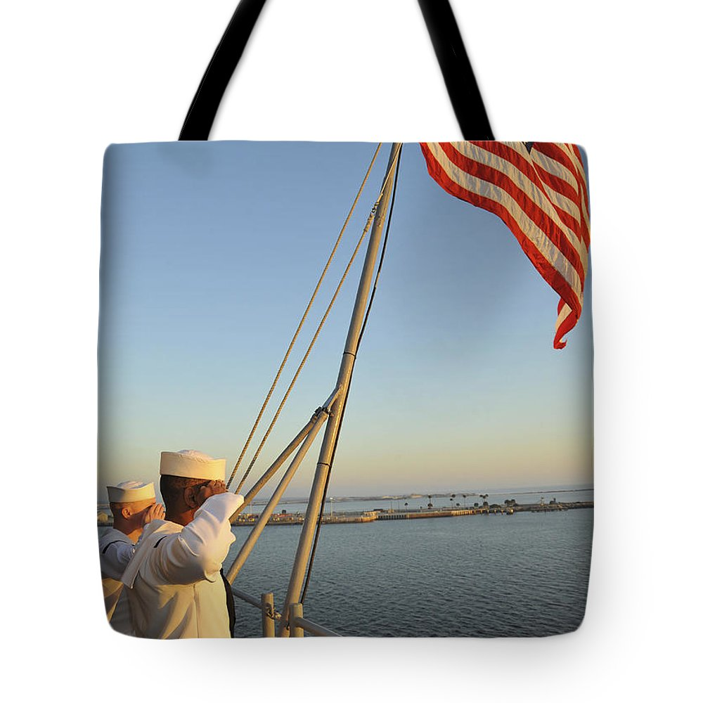 Military Tote Bag featuring the photograph Sailors Salute The National Ensign by Stocktrek Images