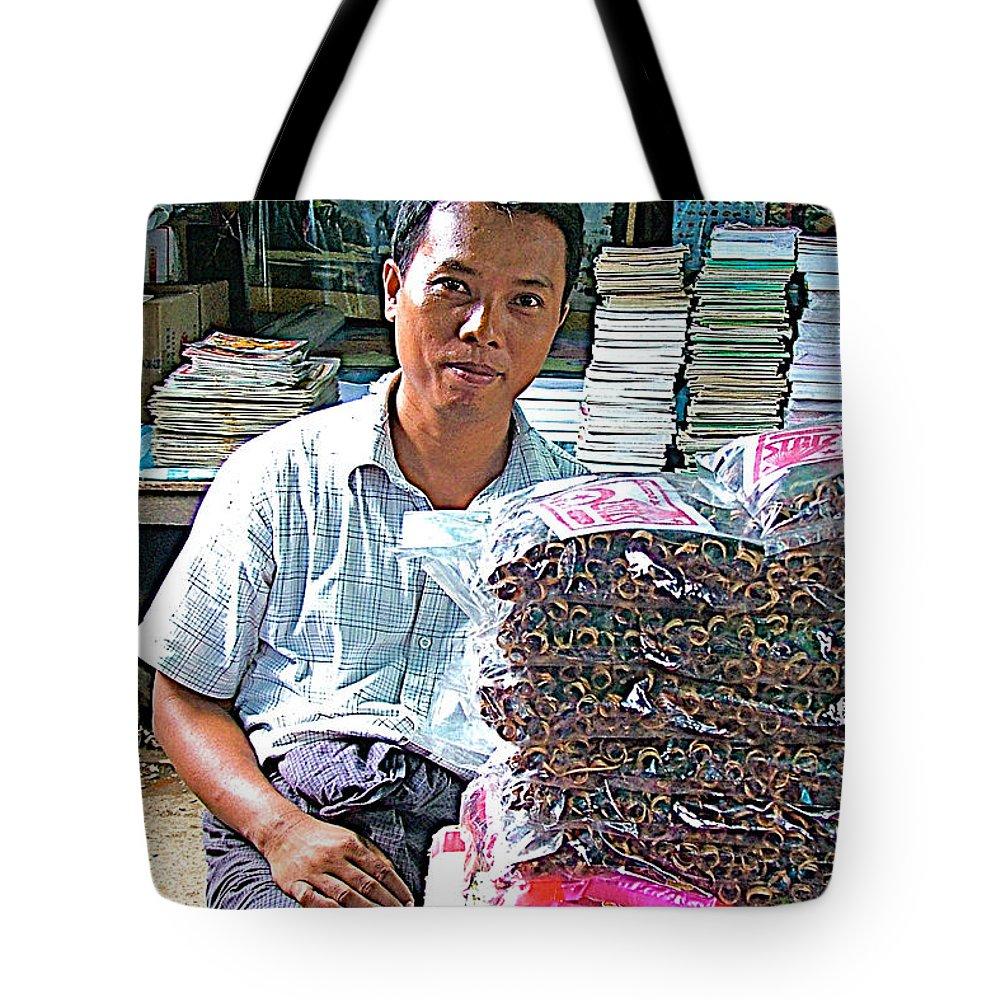 Salesman In Marketplace In Tachilek Tote Bag featuring the photograph Salesman In The Marketplace In Tachilek-burma by Ruth Hager