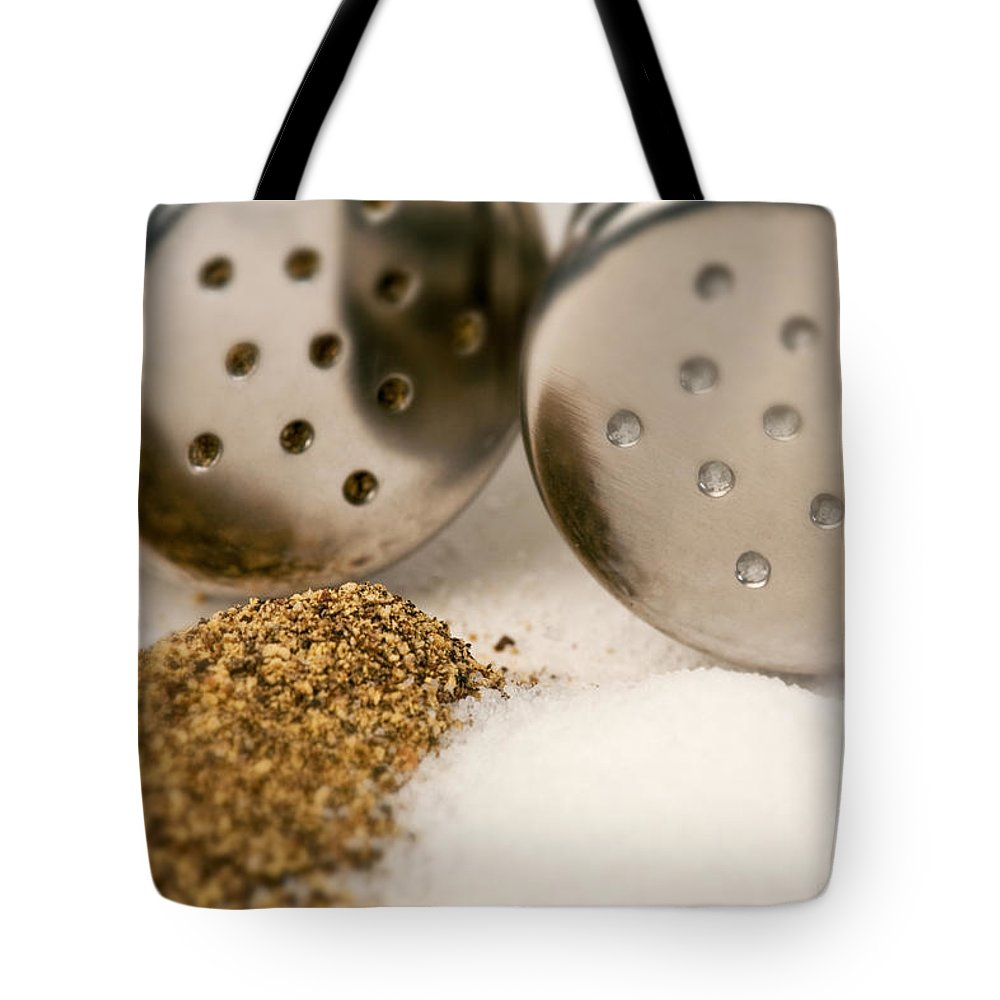 Iris Holzer Richardson Tote Bag featuring the photograph Salt And Pepper Shaker Spilled by Iris Richardson