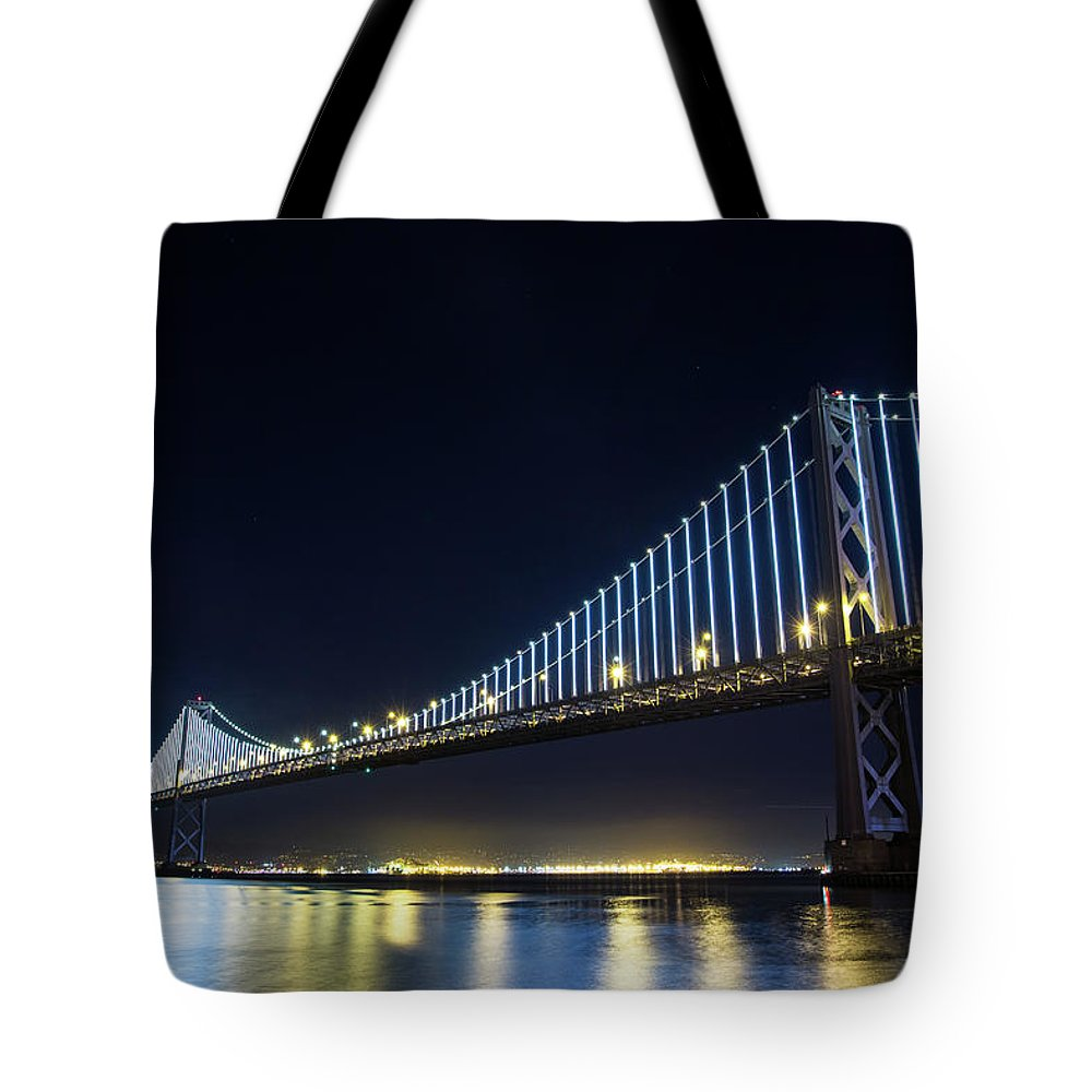 California Tote Bag featuring the photograph San Francisco Bay Bridge With Led Lights by Halbergman