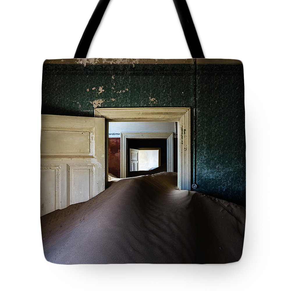 Sand Dune Tote Bag featuring the photograph Sand Dune In Door Frame Of Abandoned by Pixelchrome Inc