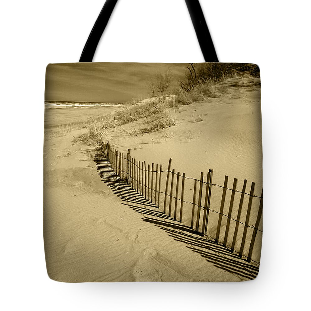 Sand Dunes Tote Bag featuring the photograph Sand Dunes And Fence by Timothy Johnson