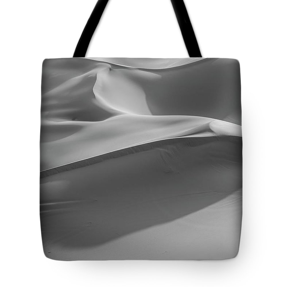 Sand Dune Tote Bag featuring the photograph Sand Dunes In The Desert, Monochrome by Moritz Wolf