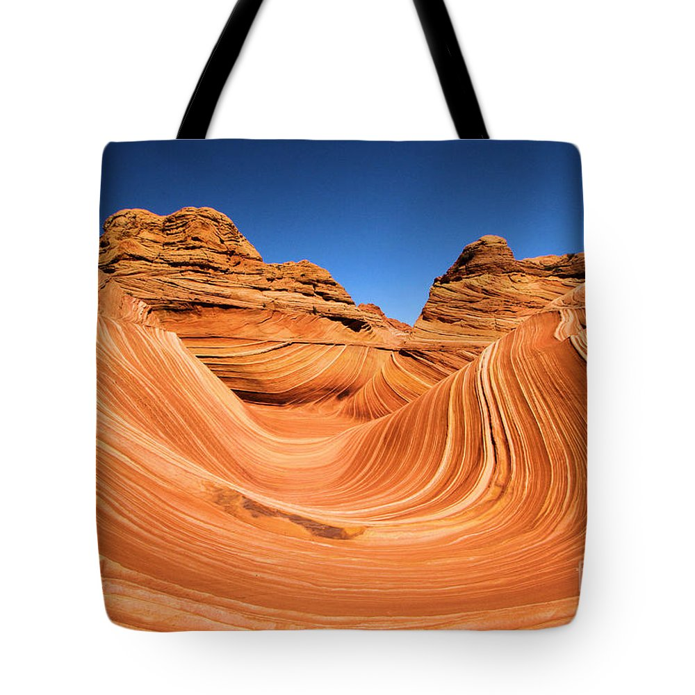 The Wave Tote Bag featuring the photograph Sandstone Surf by Adam Jewell
