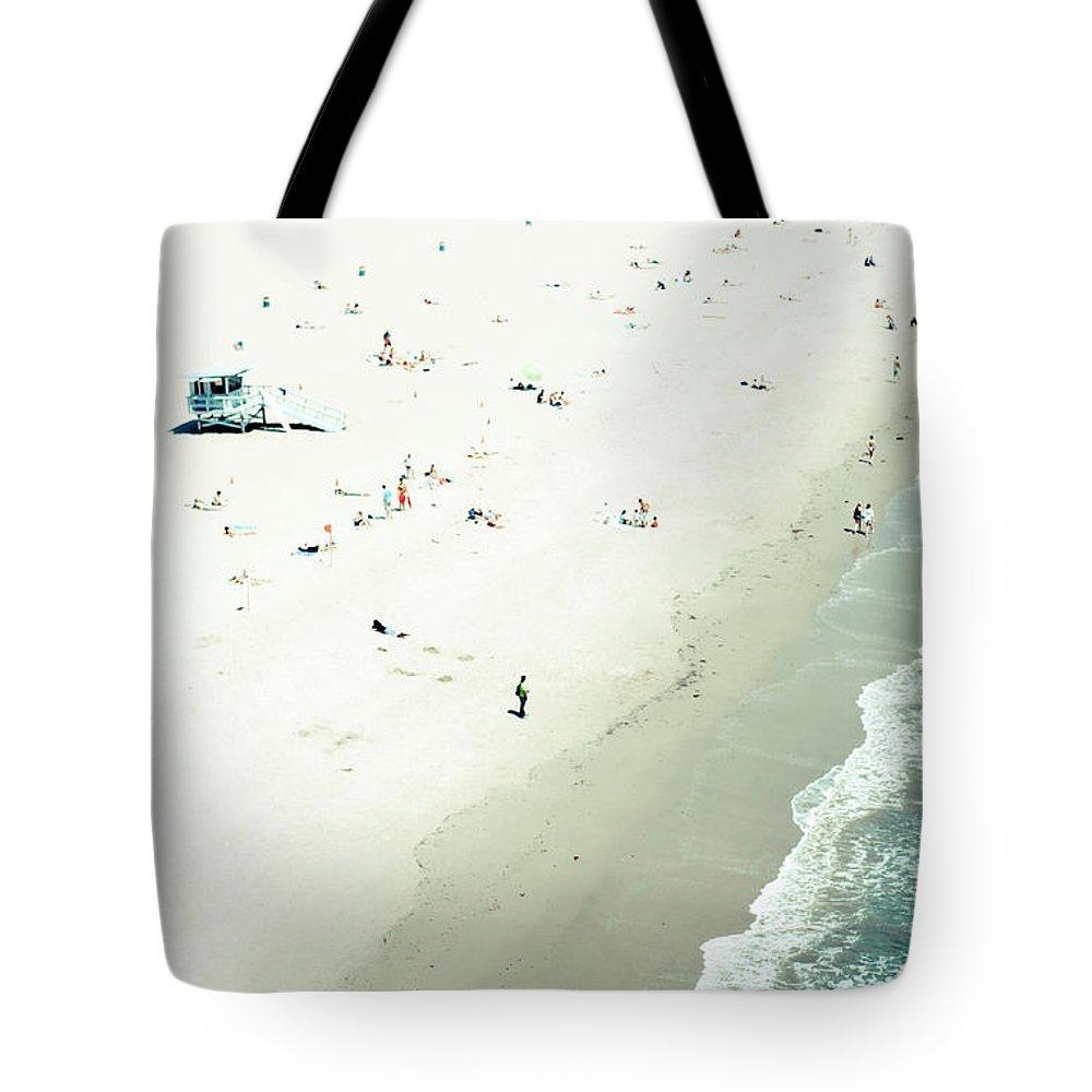 Water's Edge Tote Bag featuring the photograph Santa Monica Beach by Angela Auclair