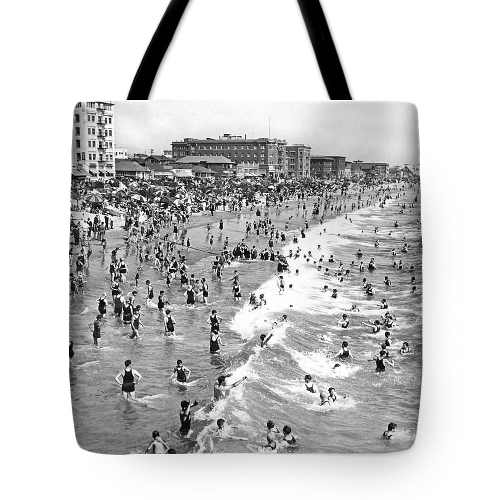 1920's Tote Bag featuring the photograph Santa Monica Beach In December by Underwood Archives