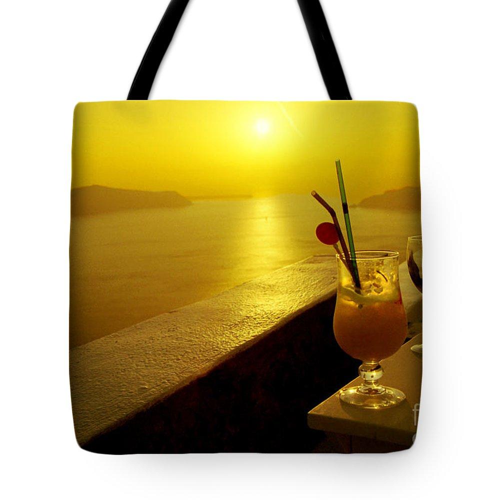 Santorini Tote Bag featuring the photograph Santorini Sunset by Madeline Ellis