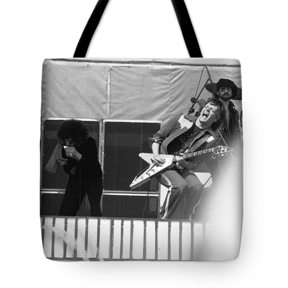 Magic Dick Tote Bag featuring the photograph Screaming Guitsr Of J. Geils 1976 by Ben Upham