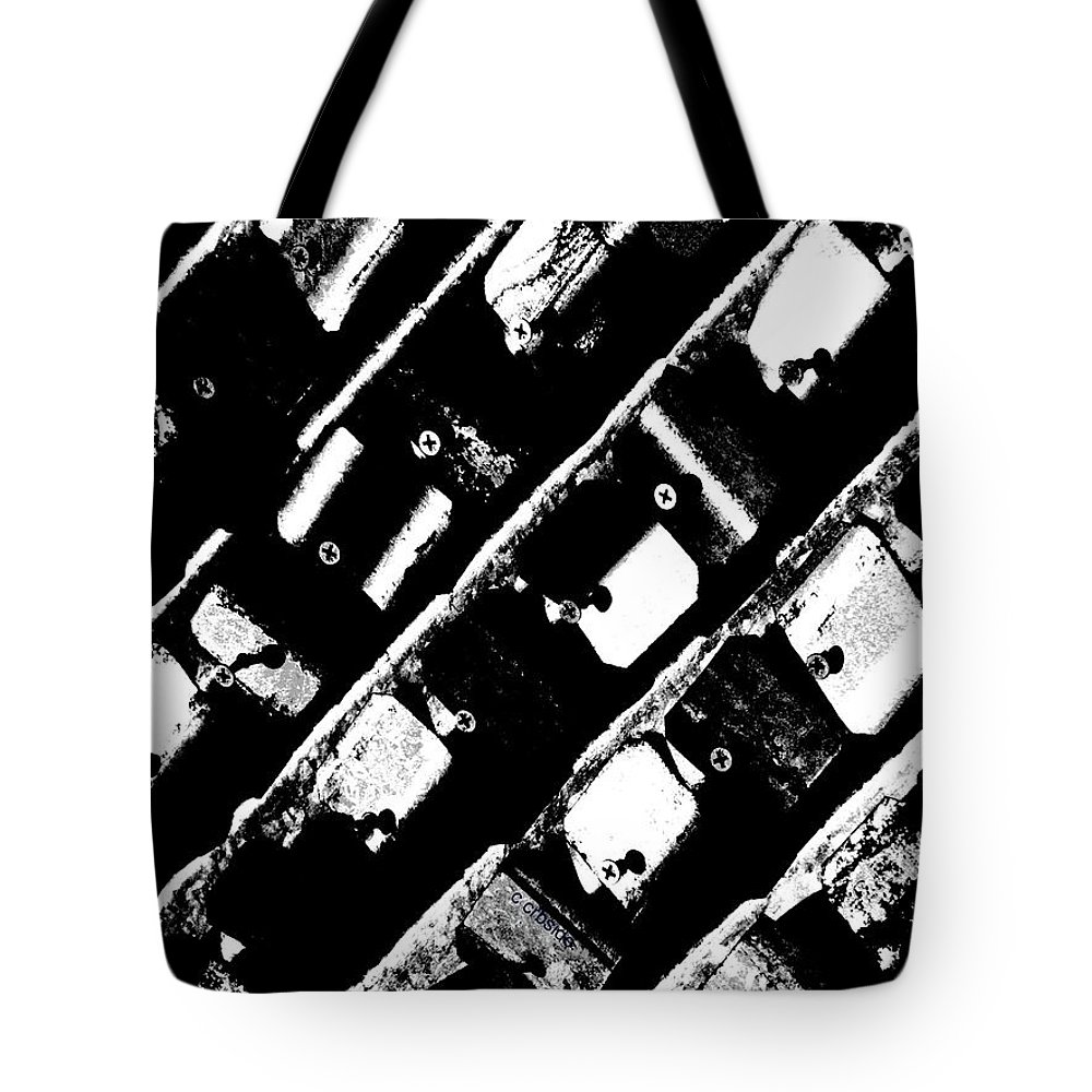 Urban Tote Bag featuring the photograph Screwed Metal Tab Abstract by Chris Berry