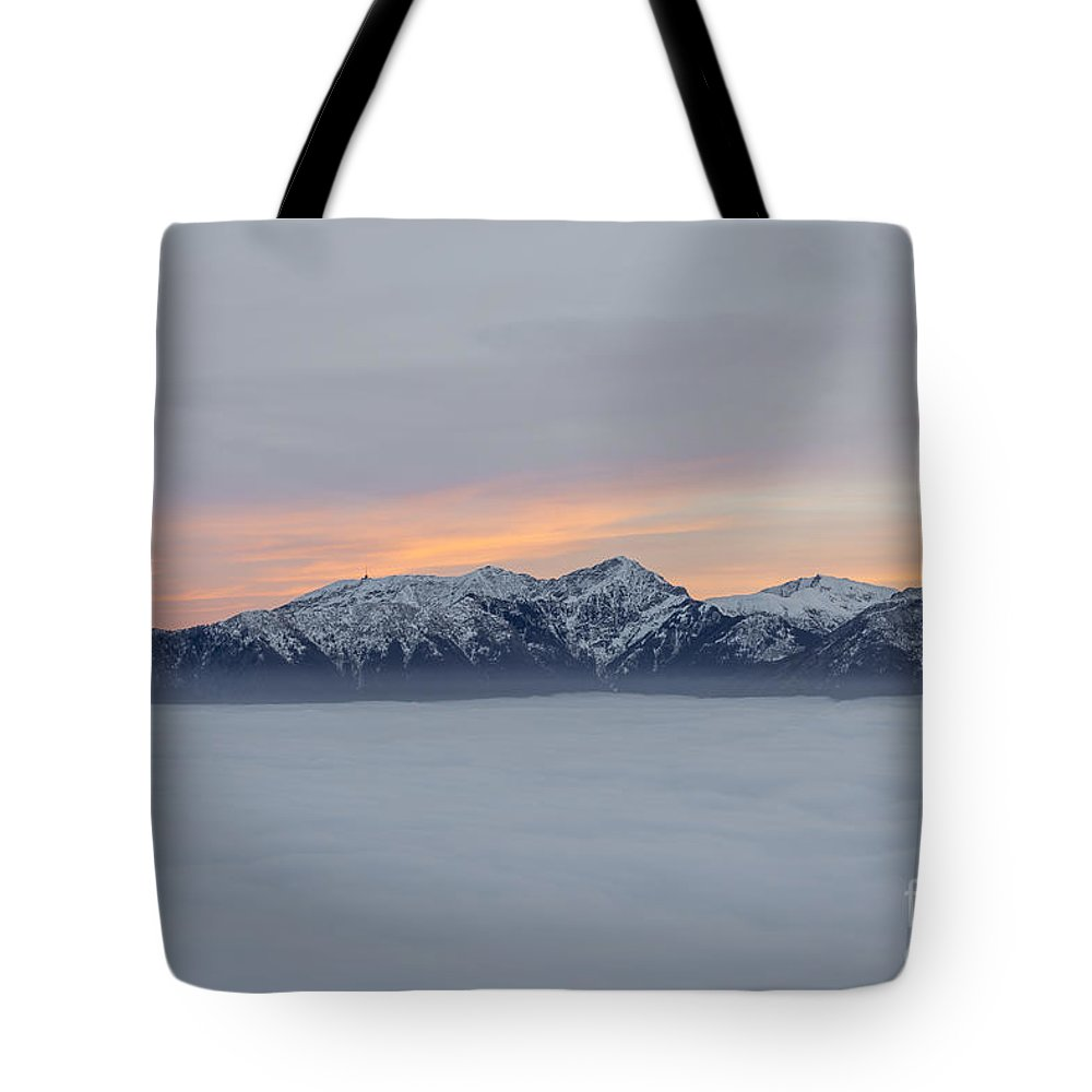 Sea Of Fog Tote Bag featuring the photograph Sea Of Fog And Snow-capped Mountain In Sunset by Mats Silvan