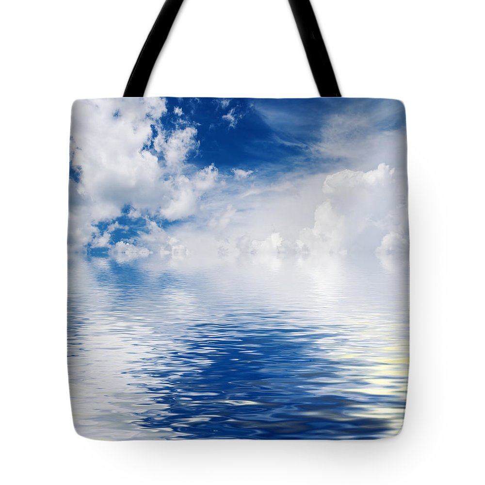 Abstract Tote Bag featuring the photograph Sea Sun And Clouds by Antonio Scarpi