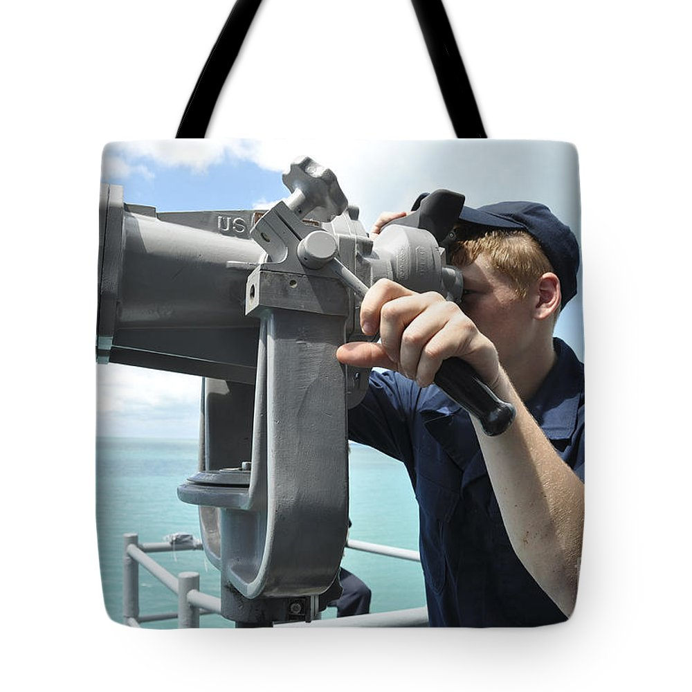 Military Tote Bag featuring the photograph Seaman Mans The Big Eyes Aboard by Stocktrek Images