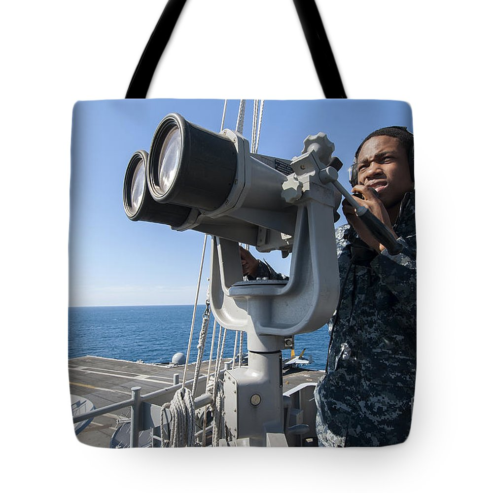 Military Tote Bag featuring the photograph Seaman Stands Lookout Aboard by Stocktrek Images