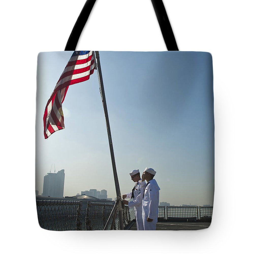 Military Tote Bag featuring the photograph Seamen Participate In Morning Colors by Stocktrek Images