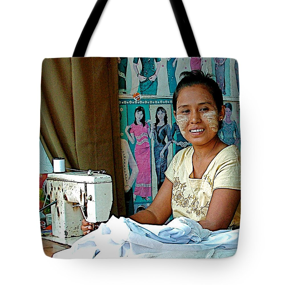 Seamstress At Her Sewing Machine In Tachilek Tote Bag featuring the photograph Seamstress At Her Sewing Machine In Tachilek-burma by Ruth Hager