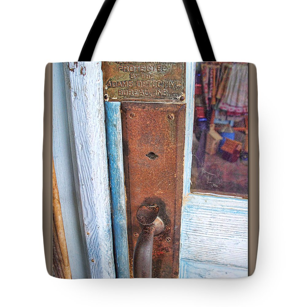 Arcitecture Tote Bag featuring the photograph Security by Debbie Portwood