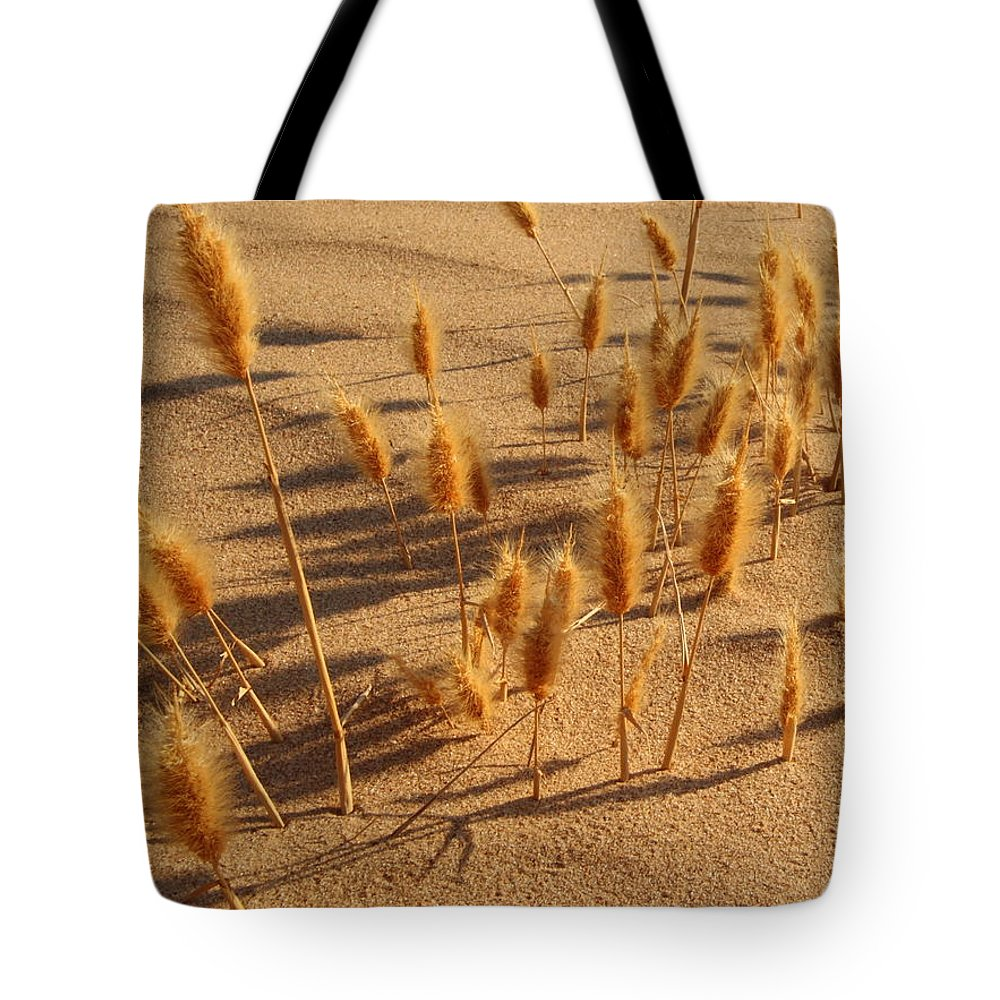 Brazos River Tote Bag featuring the photograph Seed And Sand by Andrew McInnes