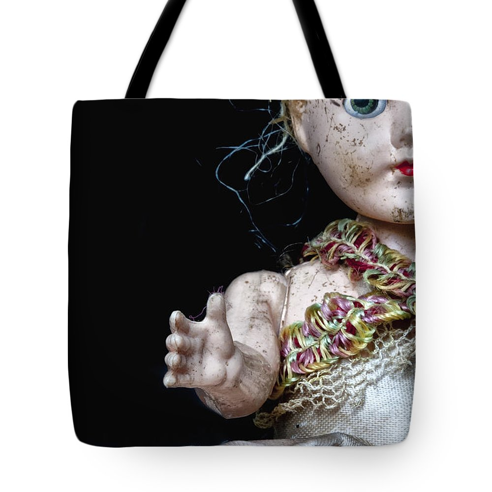Antique; Broken; Childhood; Cracked; Dirty; Doll; Eerie; Eyes; Face; Gazing; Heirloom; Nostalgia; Old; Retro; Ruined; Scary; Staring; Toy; Vintage; Weird; Worn; Dark; Creepy; Female; Dress; Porcelain; Girl; Arm; Hair; Matted; Black; Caucasian; Vintage Tote Bag featuring the photograph Seeking Attention by Margie Hurwich