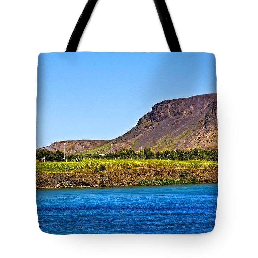 Selfoss Tote Bag featuring the photograph Selfoss by Roberta Bragan