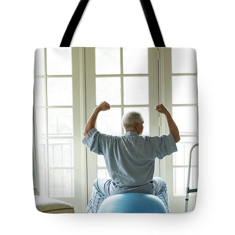Human Arm Tote Bag featuring the photograph Senior African American Man On Fitness by Tvp Inc